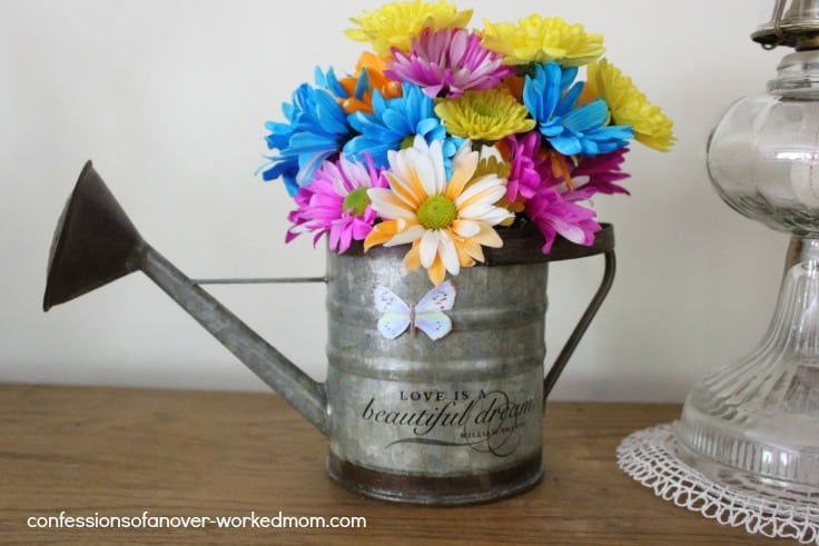 flowers in a metal watering can