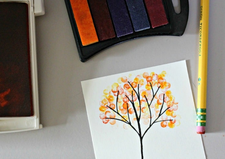 a rubber stamp pad and designed card