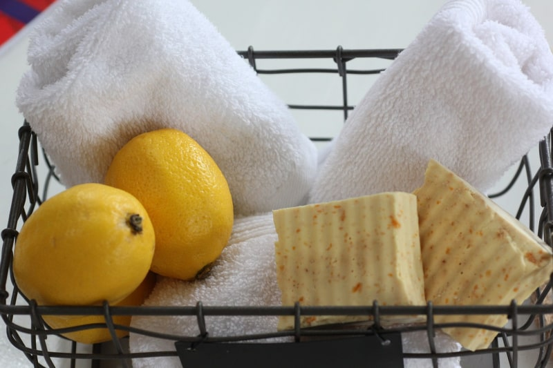 soap in a basket with white towels