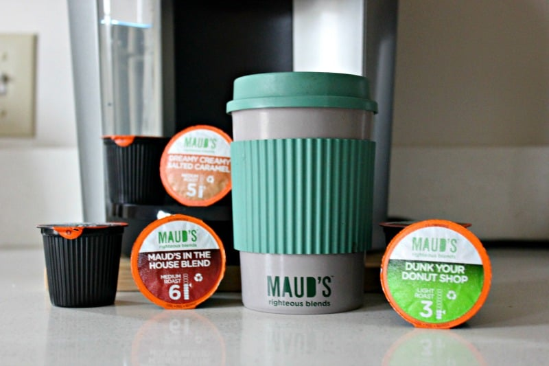 gourmet coffee k-cups near a cup