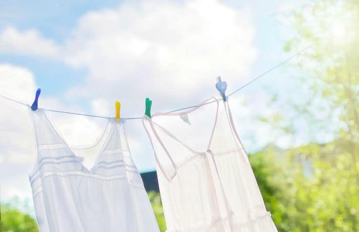4 all natural laundry boosters to whiten whites, remove odors and eliminate stains