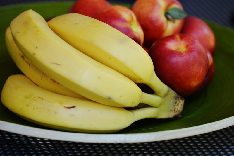 bananas and apples on a plate